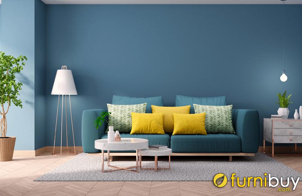 Xác định vị trí cần treo tranh là  bức tường phía sau trên ghế sofa